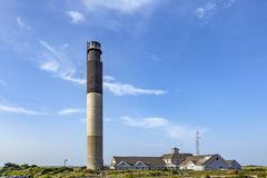 Oak Island Lighthouse. In the Town of Caswell Beach near the mouth of the Cape Fear royalty free stock photo