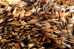 Oak planks and logs. A pile of oak planks and logs Stock Images