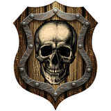 Oak shield with skull and metal studs Royalty Free Stock Photography