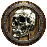 Oak shield with skull and metal studs Stock Image