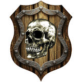 Oak shield with skull and metal studs Stock Photography