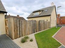 Free Oak Sleeper Fence Surrounding Back Yard Royalty Free Stock Photo - 110640385