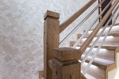Oak stair posts and decorative wall cover - handmade royalty free stock photo