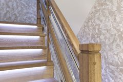 Oak stair posts and decorative wall cover - handmade royalty free stock images