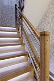 Oak stair posts and decorative wall cover - handmade royalty free stock photography