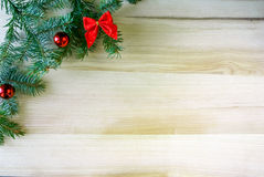 Oak table and a sprig of fir with toys. Christmas background: oak table and a sprig of fir with toys, copy space Royalty Free Stock Photo