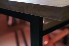 Oak table on steel legs Stock Image
