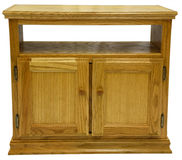 Oak TV Stand. Country Style Oak TV Stand in Golden Oak Finish Royalty Free Stock Photo