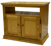 Oak TV Stand. Country Style Oak TV Stand in Golden Oak Finish Royalty Free Stock Photos