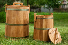 Oak barrels. On green grass Royalty Free Stock Images
