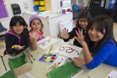 Oak View, California, USA, December 15, children doing finger painting after school Royalty Free Stock Photography