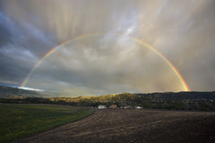 Oak View, California, USA, March 1, 2015, full rainbow over rain storm in Ojai Valley Stock Image