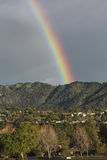Oak View, California, USA, March 1, 2015, full rainbow over rain storm over mountains Ojai Valley Royalty Free Stock Photo