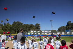 Oak View, California, USA, March 7, 2015, Ojai Valley Little League Field,youth  Baseball, Spring, hats tossed in air Royalty Free Stock Images