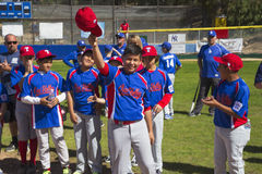 Oak View, California, USA, March 7, 2015, Ojai Valley Little League Field,youth  Baseball, Spring, raise their caps when name is a Stock Images
