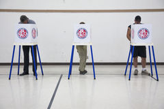 Oak View, California, USA, November 4, 2014, citizen votes in election booth polling station in gymnasium Royalty Free Stock Photos