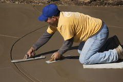 Oak View, California, USA, October 18, 2014, Hispanic concrete workers spread wet concrete for driveway Royalty Free Stock Photography