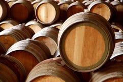 Stacks of wooden oak wine barrels. Stack of wooden wine barrels stored in a winery stock photos