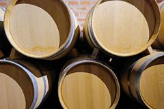 Oak wine barrels in the cellar of a Malbec winery factory in San Juan, Argentina, South America, also seen in Mendoza. Oak wine barrels stacked in the cellar of royalty free stock photos