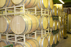 Oak Wine Barrels in a Rack. Wine barrels full of aging wine and stored in a rack at the Brushy Creek Winery in Texas Stock Images