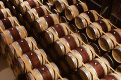 Oak wine barrels stacked in modern winery. View from above. In underground cellar Royalty Free Stock Images