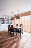 Oak wood dining table. In exclusive interior Royalty Free Stock Images