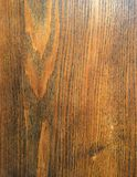 Oak Wood Grain Background. Dark brown stained oak wood showing natural grain in variations of dark brown chestnut shades. Natural rustic furniture finish for an Royalty Free Stock Images