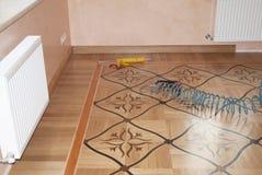 Oak wood parquet batten installation. Close up on wooden batten installation and repair on oak wood parquet. Oak parquet batten installation. Close up on wooden stock photo