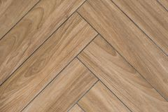 Oak wood texture of floor with tiles immitating hardwood flooring. Traditional herringbone pattern.  stock image