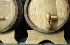 Oak wooden barrels with a taps. Stock Images