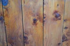 Oak wooden decking with knotting. Dark Oak wooden decking with knotting and texture Stock Image