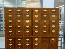 Oak wooden library catalog drawer sitting in a modern library royalty free stock images