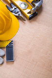Oaken wooden board with composition of. Construction objects repairing concept Stock Photography