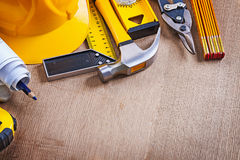 Oaken wooden board with variation of building working tools repa. Iring concept Stock Image