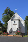 Oakhurst. A white church in Oakhurst, California on a sunny day with a perfect blue skynn Royalty Free Stock Photo