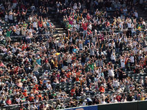 Oakland As fans do the wave during a game Royalty Free Stock Images