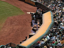 Oakland Athletics Dugout and fans behind them Stock Image