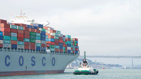 Cargo Ship COSCO FAITH departing the Port of Oakland Royalty Free Stock Images