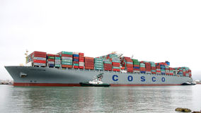 Cargo Ship COSCO FORTUNE entering the Port of Oakland. Oakland, CA - November 15, 2016: Multiple tugboats assist cargo ship COSCO FORTUNE to maneuver into the Royalty Free Stock Photos