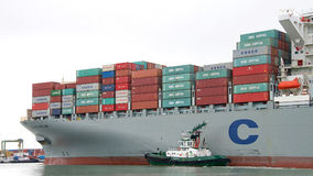 Cargo Ship COSCO FORTUNE entering the Port of Oakland. Oakland, CA - November 15, 2016: Tugboat AMERICA off the bow of cargo ship COSCO FORTUNE, assisting the Royalty Free Stock Photo