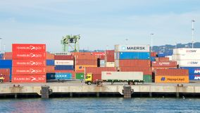 Stacks of shipping containers line the docks at the Port of Oakland stock images
