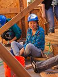 Woman talks while working for Habitat For Humanity Royalty Free Stock Photography