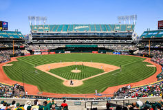 Oakland Coliseum Baseball Stadium Day Game. A view of Oakland-Alameda County Overstock.com Coliseum, home of the Major League Baseball Oakland A's, from behind
