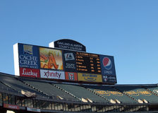 Oakland Coliseum Two Screen Scoreboard. OAKLAND, CA - AUGUST 16: Oakland-Alameda County Coliseum Two Screen Scoreboard featuring the Oakland Athletics Logo and Stock Photo