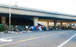 Oakland, homeless encampment under the freeway. Captures the homeless problem in Oakland California. Tent cities and trash pile up in huge camps as veterans stock photos