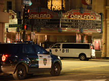 Oakland Police On The Prowl. Oakland police officers stationed in the Uptown looking for trouble makers on a Friday night in the Bay Area Royalty Free Stock Photography