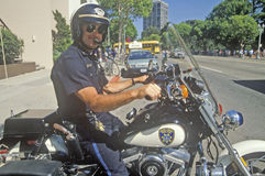 Oakland policeman poses on his motorcycle in Oakland, California Stock Image