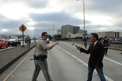 Oakland Protest. California Highway Patrol and News Reporter fighting on Interstate 880. Get off the, freeway! This is your fault!!!! -CHP to News Reporter Royalty Free Stock Photography