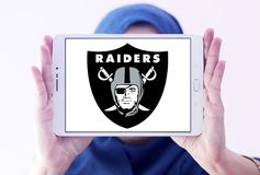 Oakland Raiders american football team logo. Logo of Oakland Raiders club on samsung tablet holded by arab muslim woman. The Oakland Raiders are a professional Royalty Free Stock Images