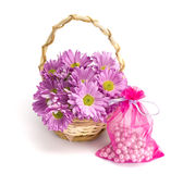 Oaklets in a basket and a sack with pearls. On the white isolated background Stock Photography